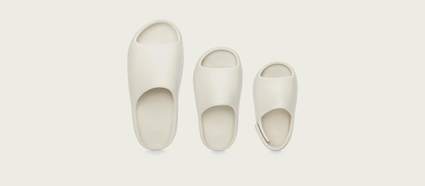 Tres modelos de las chanclas Yeezy Slide para adulto, niño y bebé